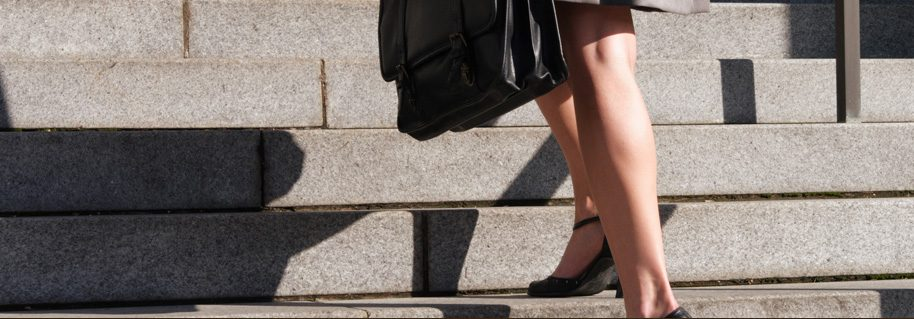 Woman on Steps at Risk of Slip and Fall