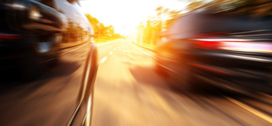 View of Two Cars on Road at High Speed