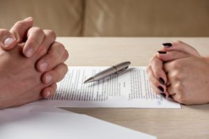 male and female hands over contract